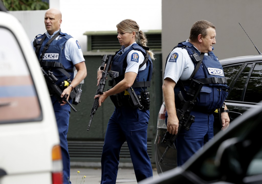 Armed police patrol outside a mosque in central Christchurch, New Zealand, Friday, March 15, 2019. A witness says many people have been killed in a ma