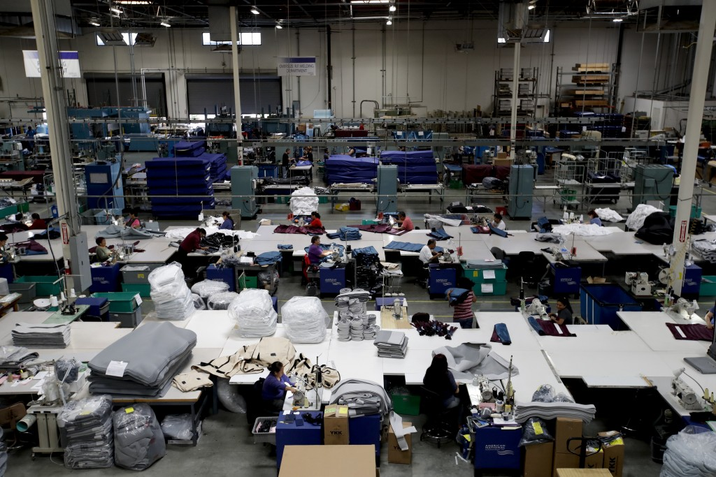 FILE- In this July 5, 2018, file photo workers assemble the Afloat water mattresses at the factory in Corona, Calif. On Friday, March 15, 2019, the Fe