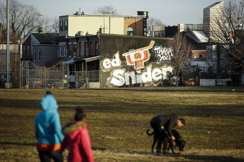 In this Feb. 21, 2019 photo a mural dedicated to Ed Snider is seen on the side of a home near the Scanlon Ice Rink in Philadelphia. Snider Hockey, the