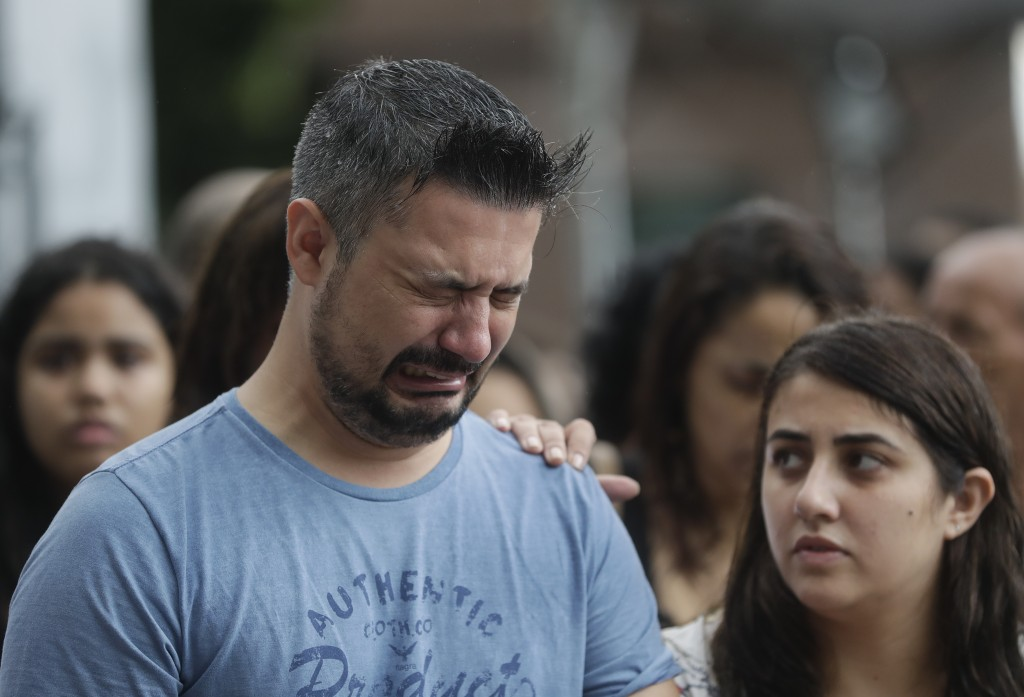 A relative grieves at the burial service of 15-year-old Kaio Lucas da Costa Limeira, a victim of the the mass shooting at the Raul Brasil State School