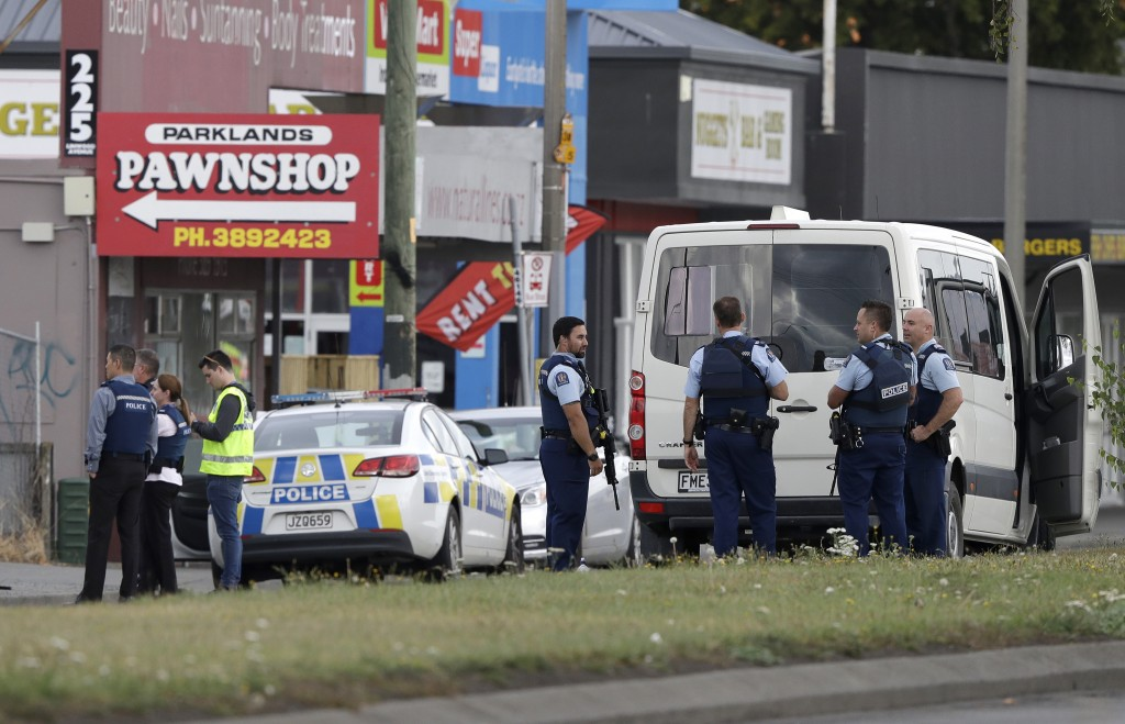 Police stand outside a mosque in Linwood, Christchurch, New Zealand, Friday, March 15, 2019. Multiple people were killed during shootings at two mosqu