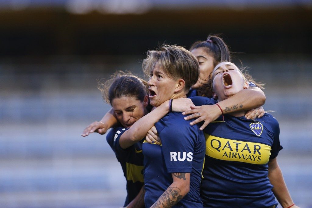 Boca Juniors' Yamila Rodriguez, center, celebrates with teammates after scoring in the Superliga women's soccer tournament in Buenos Aires, Argentina,