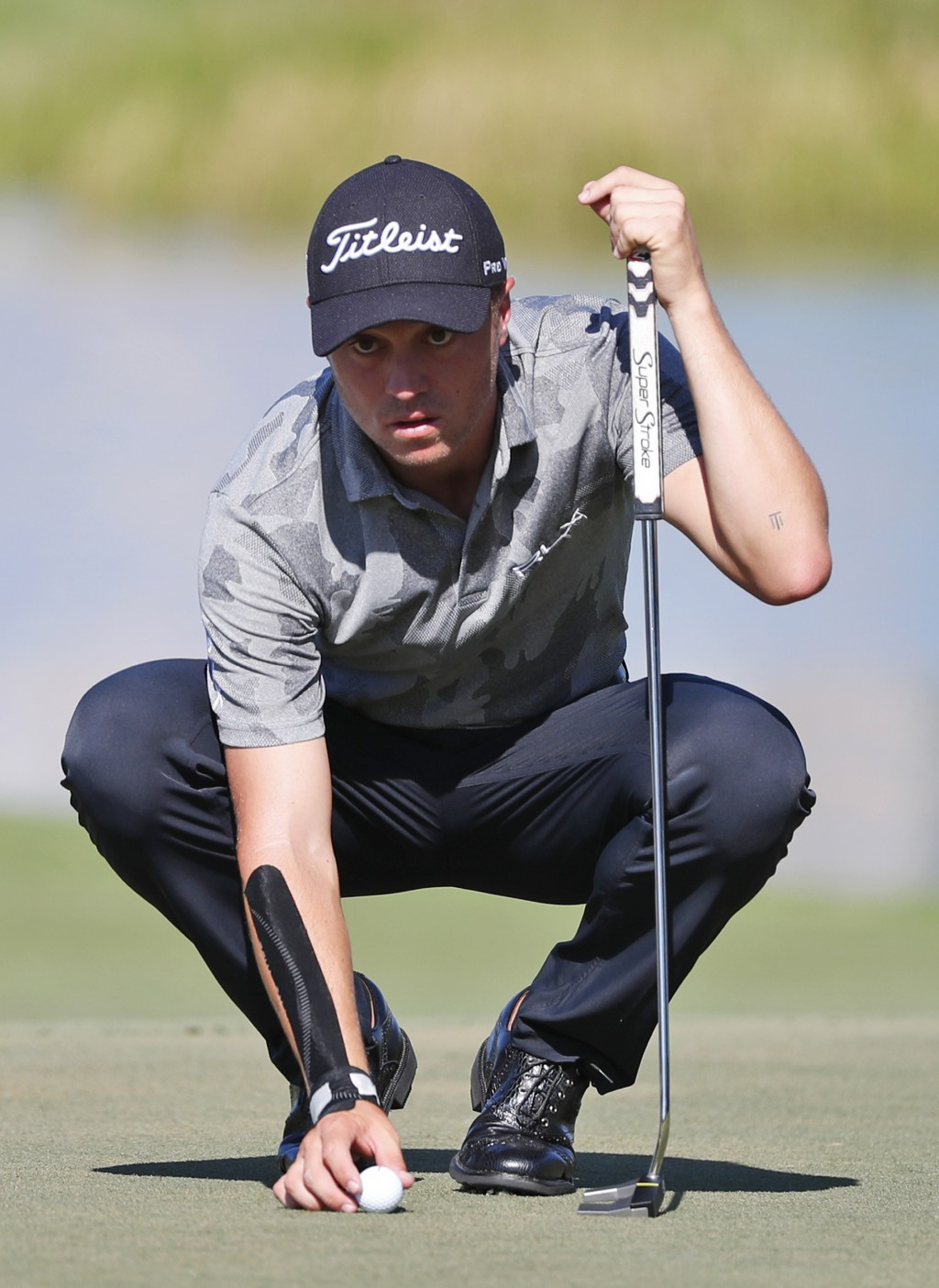 FILE - In this March 2, 2019, file photo, Justin Thomas lines up a putt on the eighth hole during the third round of the Honda Classic golf tournament