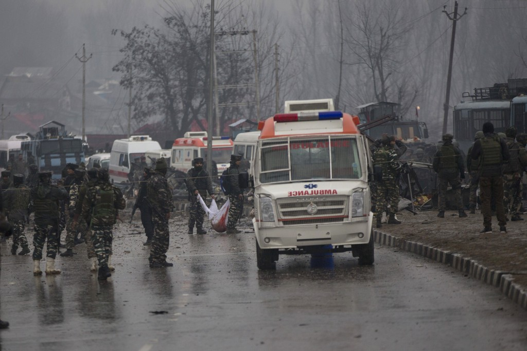 FILE - In this Feb. 14, 2019 file photo, Indian paramilitary soldiers carry the remains of colleagues at the site of a suicide bombing in Pampore, Ind
