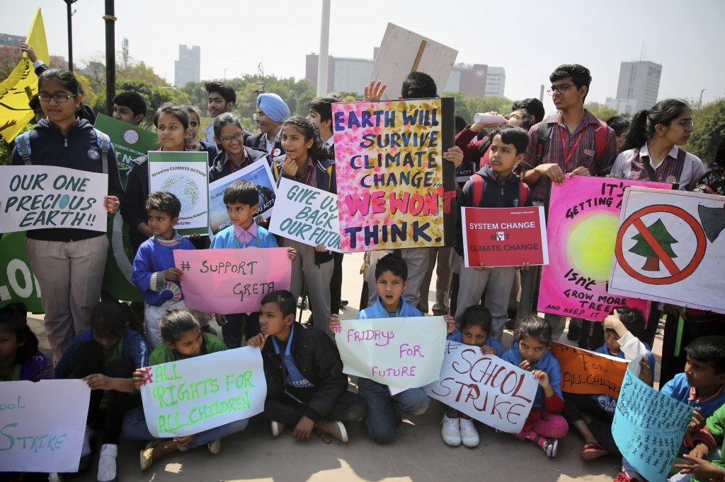 Students from different institutions hold placards and banners as they participate in a climate protest in New Delhi, India, Friday, March 15, 2019. S
