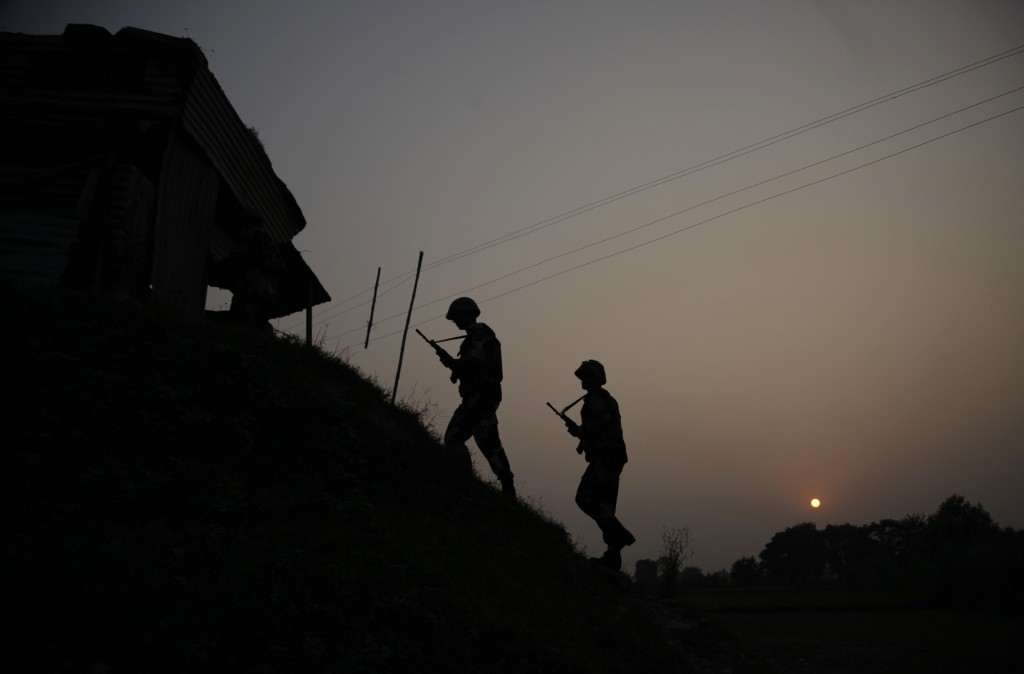 FILE - In this Oct. 1, 2016, file photo, Indian Border Security Force soldiers patrol near the India-Pakistan international border area at Gakhrial bo