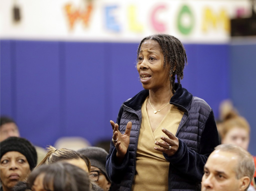 In this March 7, 2019 photo, Queensbridge Houses resident Marilyn Keller describes how her apartment has no heat or hot water and how the rust-colored