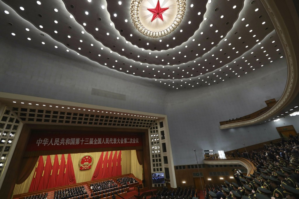 A military band plays the national anthem during the closing session of the National People's Congress in Beijing's Great Hall of the People on Friday