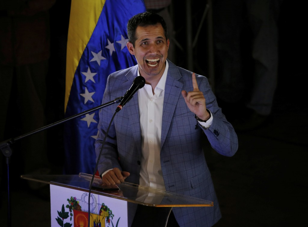 National Assembly President Juan Guaido, delivers a speech during a meeting with residents in the Hatillo municipality of Caracas, Venezuela, Thursday