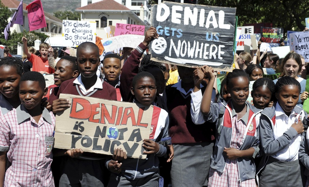 Students in Cape Town, South Africa take part in a protest, Friday, March 15, 2019 as part of a global student strike against government inaction on c...