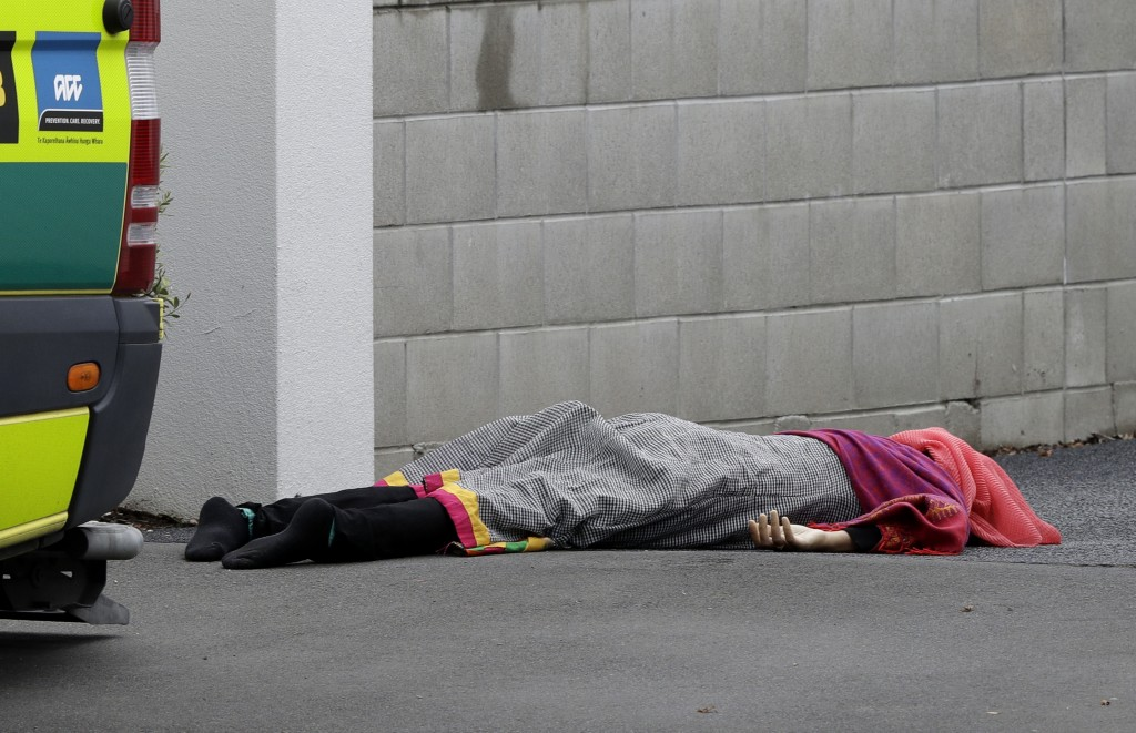 A body lies on the footpath outside a mosque in central Christchurch, New Zealand, Friday, March 15, 2019, following a mass shooting. (AP Photo/Mark B