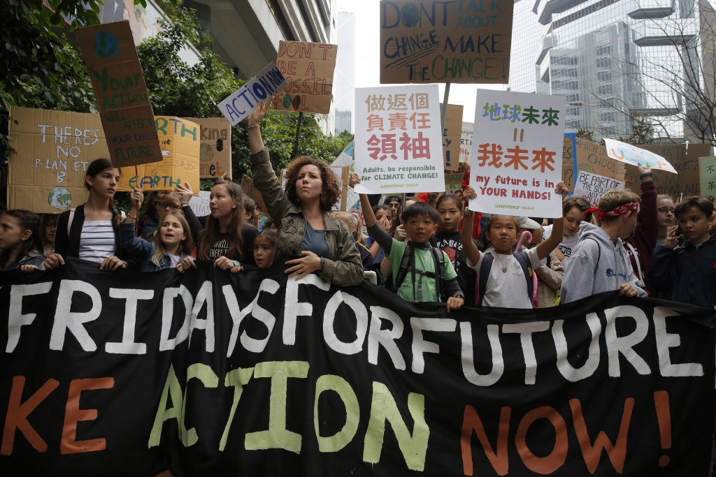 Hundreds of schoolchildren take part in a climate protest in Hong Kong, Friday, March 15, 2019. Students in more than 80 countries and territories wor