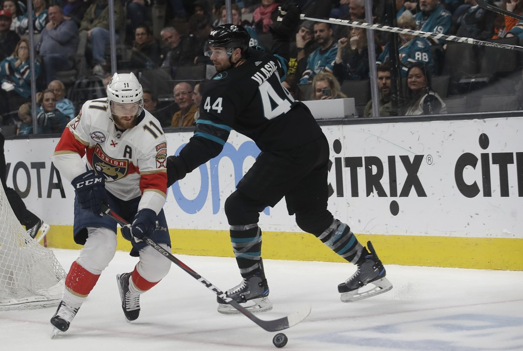 Florida Panthers left wing Jonathan Huberdeau (11) skates with the puck in front of San Jose Sharks defenseman Marc-Edouard Vlasic (44) during the sec