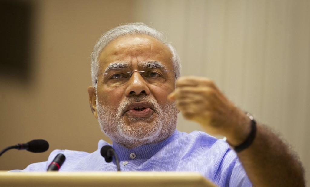 FILE - In this Aug. 28, 2014, file photo, Indian Prime Minister Narendra Modi speaks at the launch of a campaign aimed at opening millions of bank acc