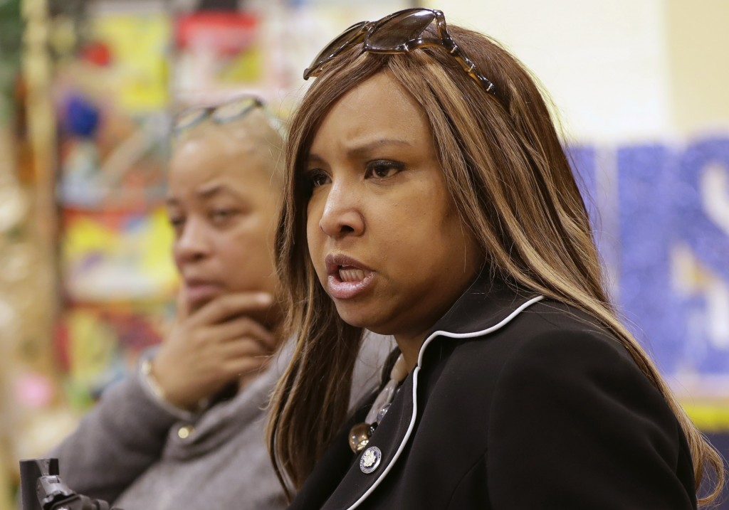 In this March 7, 2019 photo, Queensbridge Houses Tenant Association President April Simpson, left, listens as HUD executive Lynne Patton, conducts a t