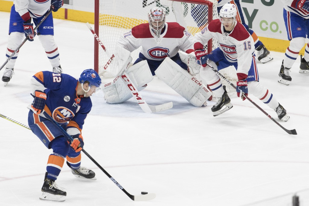 Montreal Canadiens goaltender Carey Price (31) and center Jesperi Kotkaniemi (15) tends net against New York Islanders right wing Josh Bailey (12) dur
