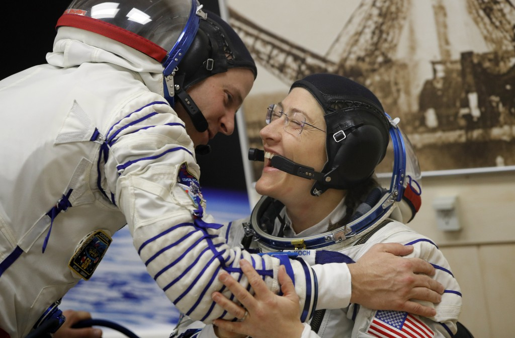 U.S. astronauts Christina Hammock Koch, right, Nick Hague, members of the main crew of the expedition to the International Space Station (ISS), speak