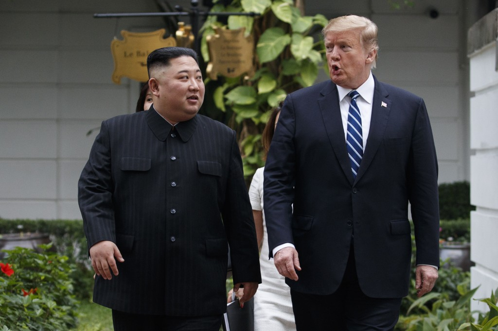 FILE - In this Feb. 28, 2019 file photo, President Donald Trump and North Korean leader Kim Jong Un take a walk after their first meeting at the Sofit