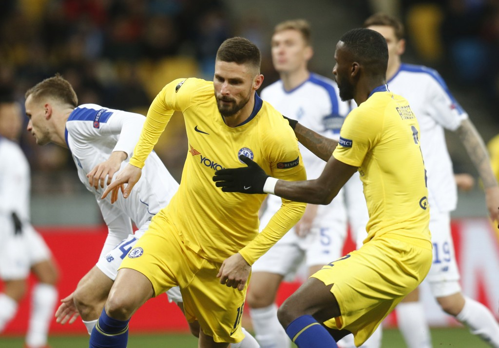 Chelsea's Olivier Giroud celebrates after scoring his side's opening goal during the Europa League round of 16, second leg soccer match between Dynamo