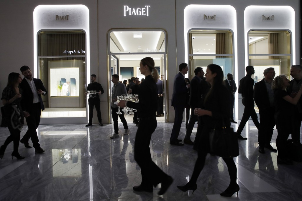 People attend the opening of a Piaget store during the opening night of The Shops & Restaurants at Hudson Yards, Thursday, March 14, 2019, in New York