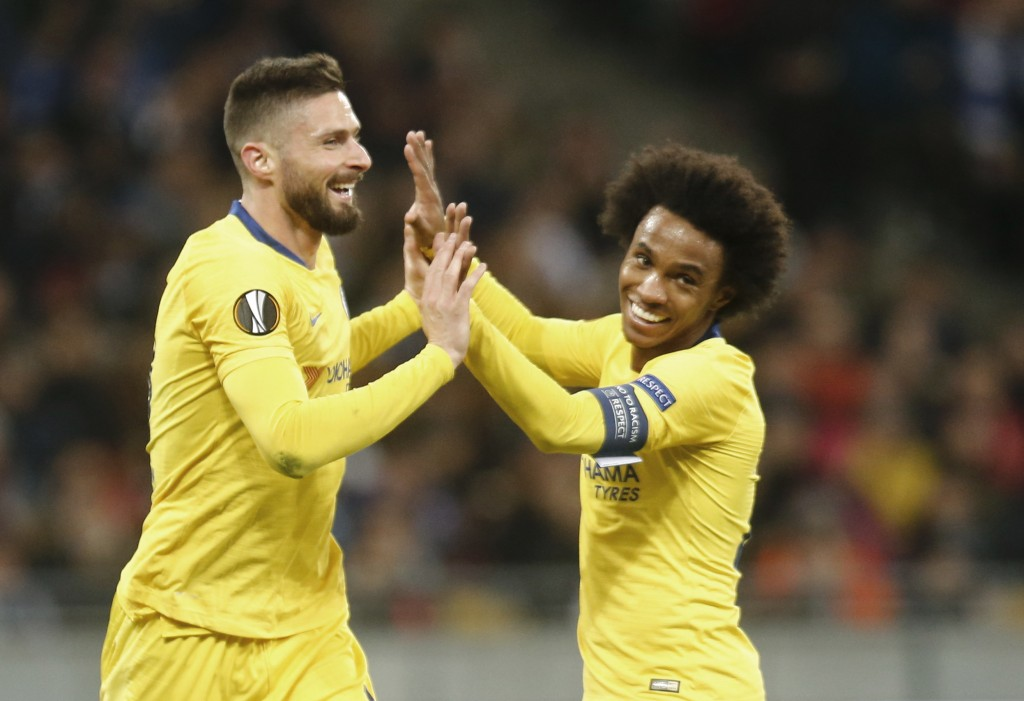 Chelsea's Olivier Giroud celebrates with his teammates Chelsea's Willian after scoring his side's second goal during the Europa League round of 16, se