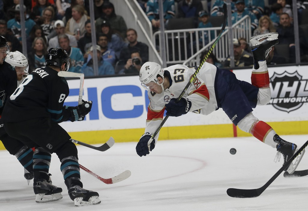 Florida Panthers right wing Evgenii Dadonov (63) falls in front of San Jose Sharks center Joe Pavelski (8) during the second period of an NHL hockey g