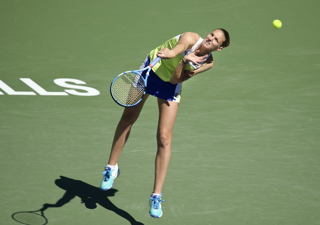 Karolina Pliskova, of the Czech Republic, serves to Belinda Bencic, of Switzerland, at the BNP Paribas Open tennis tournament Thursday, March 14, 2019