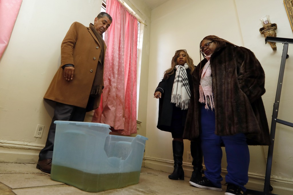 FILE - In this Feb. 19, 2019 file photo, HUD executive Lynne Patton, center, accompanied by U.S. Rep. Adriano Espaillat, left, and NYCHA Tenant Associ
