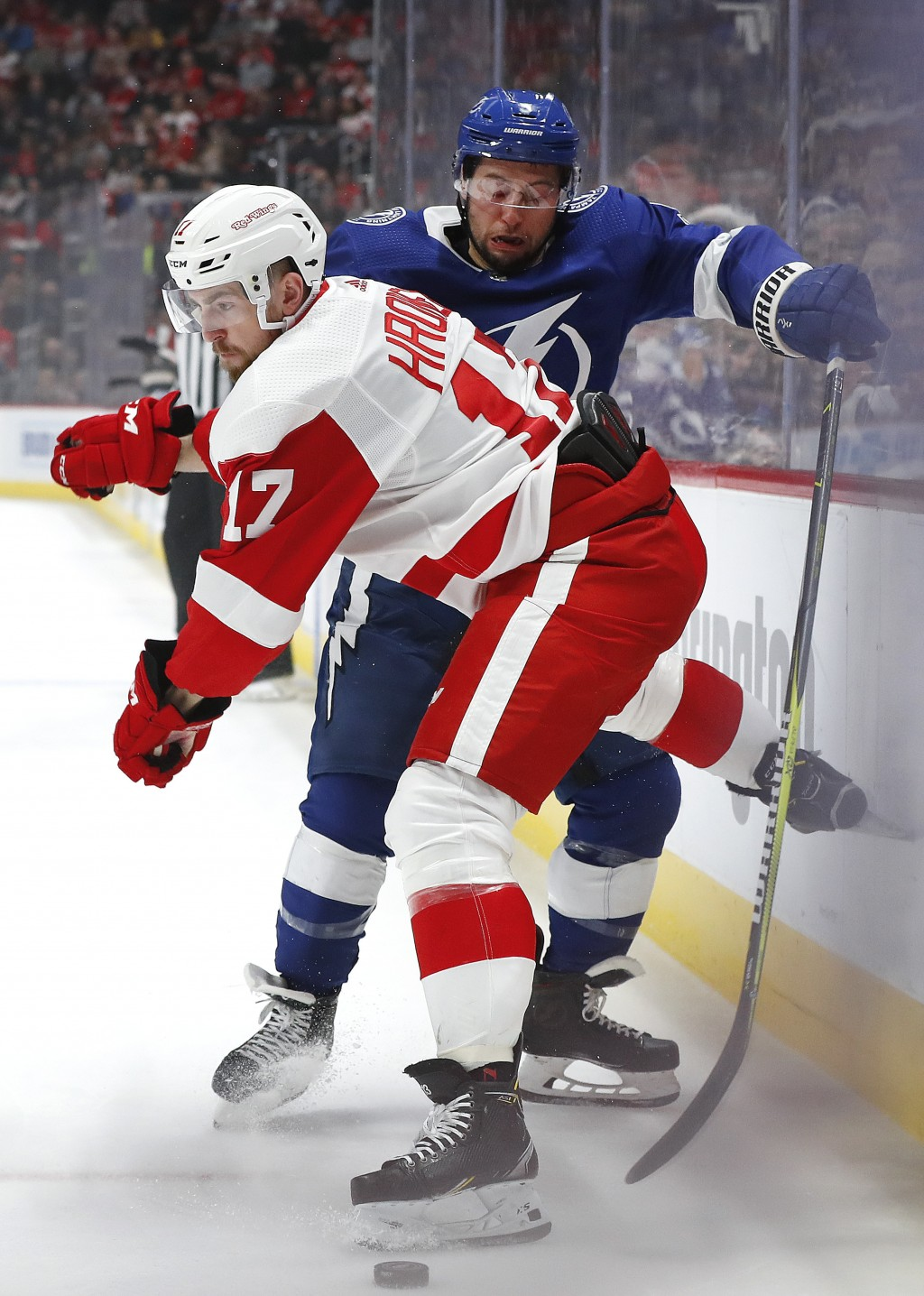 Detroit Red Wings defenseman Filip Hronek (17) checks Tampa Bay Lightning center Tyler Johnson (9) in the first period of an NHL hockey game, Thursday