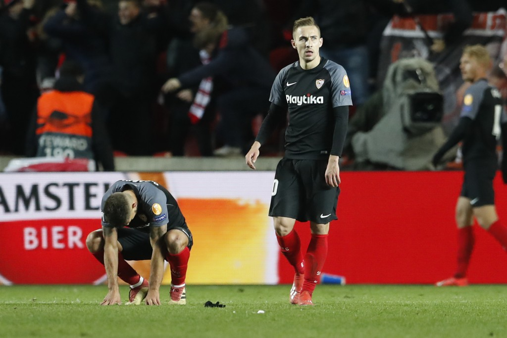 Sevilla players react to losing their Europa League Round of 16 second leg soccer match between Slavia Praha and Sevilla at the Sinobo stadium in Prag