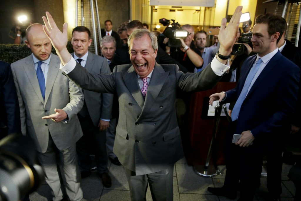 FILE - In this Friday, June 24, 2016 file photo Nigel Farage, the leader of the UK Independence Party, celebrates and poses for photographers as he le