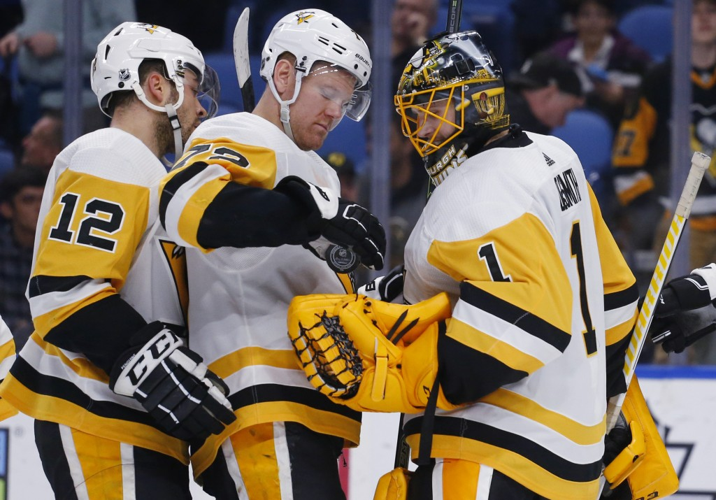 Pittsburgh Penguins forward Patric Hornqvist (72) gives the game puck to goalie Casey DeSmith (1) after the team's NHL hockey game against the Buffalo