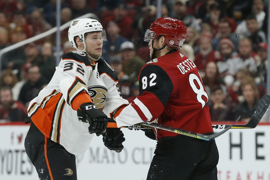 Anaheim Ducks defenseman Jacob Larsson (32) and Arizona Coyotes defenseman Jordan Oesterle scuffle during the third period of an NHL hockey game, Thur