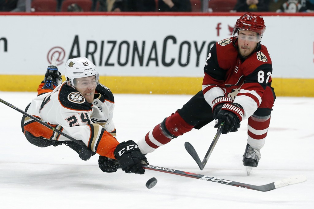 Anaheim Ducks center Carter Rowney (24) shoots in front of Arizona Coyotes defenseman Jordan Oesterle during the third period during an NHL hockey gam