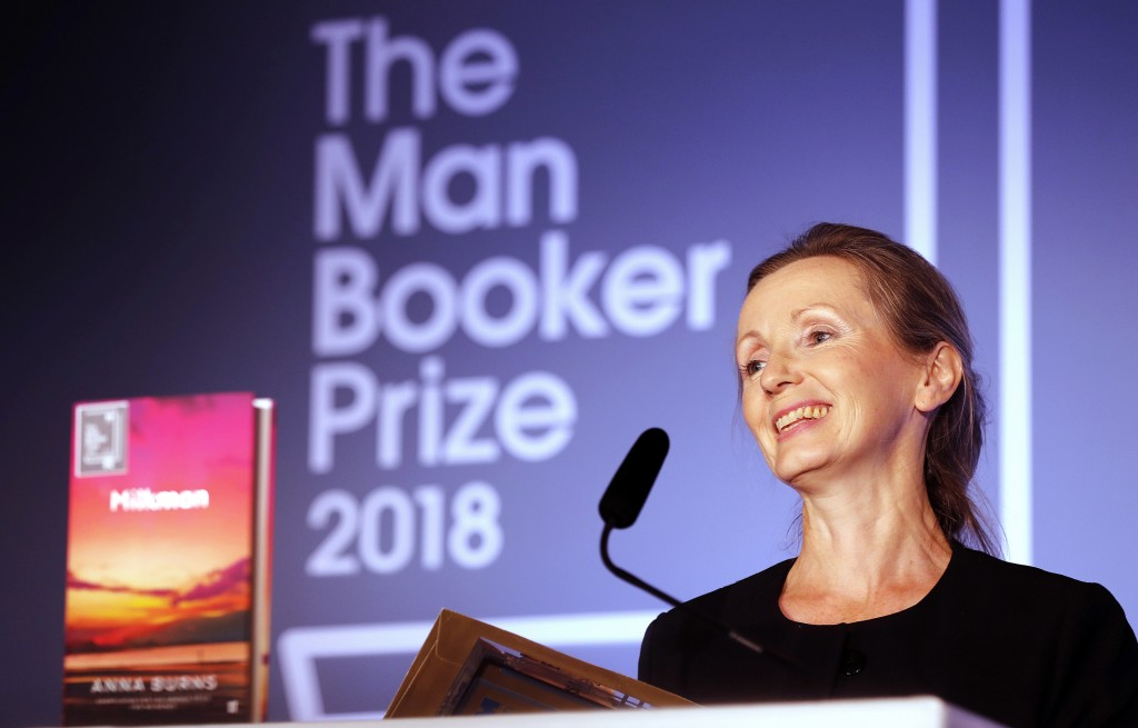 """FILE - In this Oct. 16, 2018 file photo, author Anna Burns smiles after being presented with the Man Booker Prize for Fiction 2018 for """"Milkman,"""" duri"""