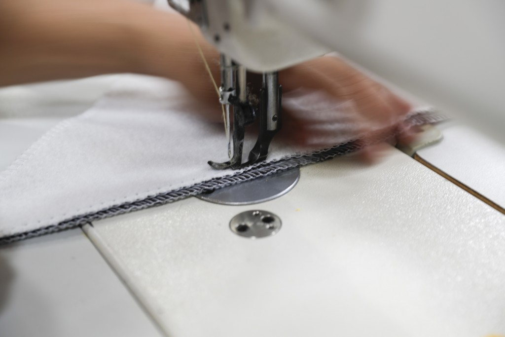FILE- In this July 5, 2018, file photo a worker sews the Afloat water bed at the factory in Corona, Calif. On Friday, March 15, 2019, the Federal Rese