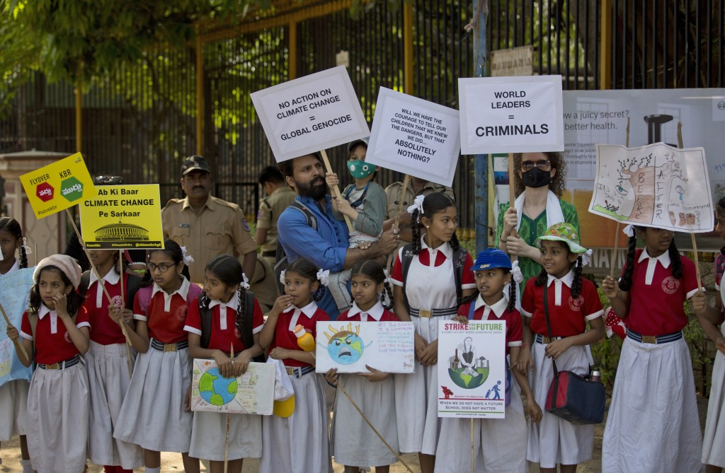 Adults stand in solidarity with Indian students in a climate protest in Hyderabad, India, Friday, March 15, 2019. Students in more than 80 countries a...