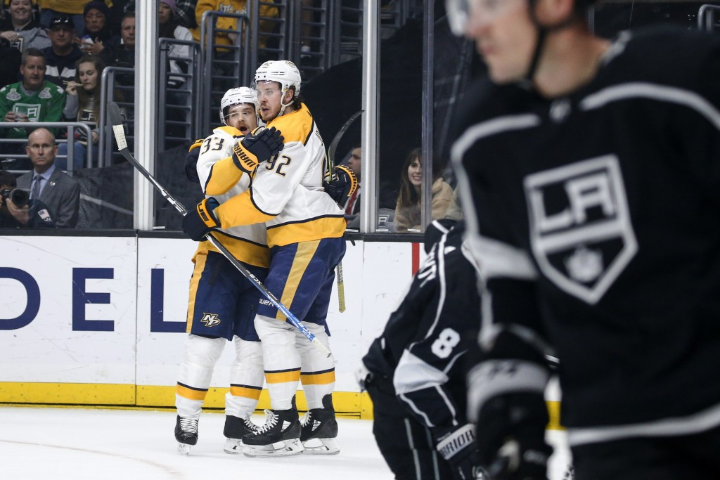 Nashville Predators forward Viktor Arvidsson (33) celebrates his goal with teammate Ryan Johansen (92) during the first period of an NHL hockey game a
