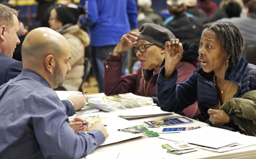 In this March 7, 2019 photo, Queensbridge Houses resident Marilyn Keller, right, talks to HUD Region 2 Management Analyst Jacob Dale, about conditions