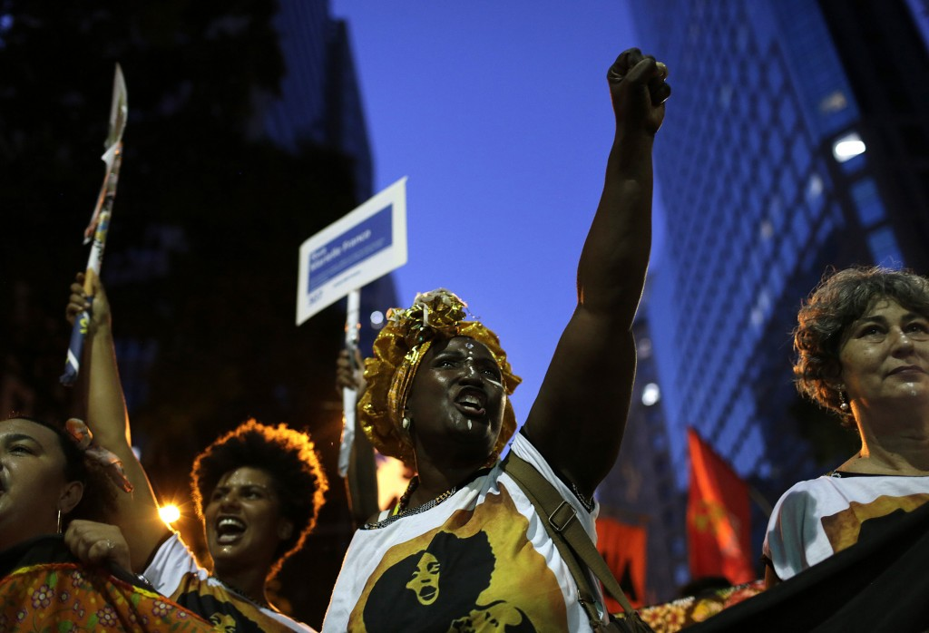 Women march marking International Women's Day in Rio de Janeiro, Brazil, on Friday, March 8, 2019. Marches and protests were held Friday across the gl