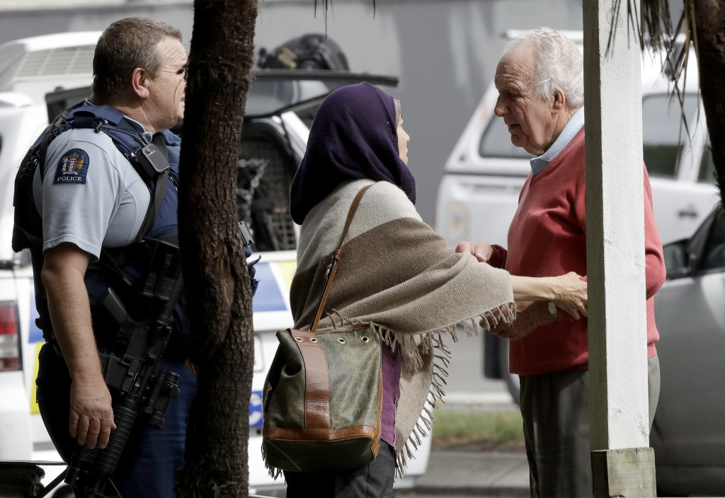 Police escort people away from outside a mosque in central Christchurch, New Zealand, Friday, March 15, 2019. Multiple people were killed in mass shoo