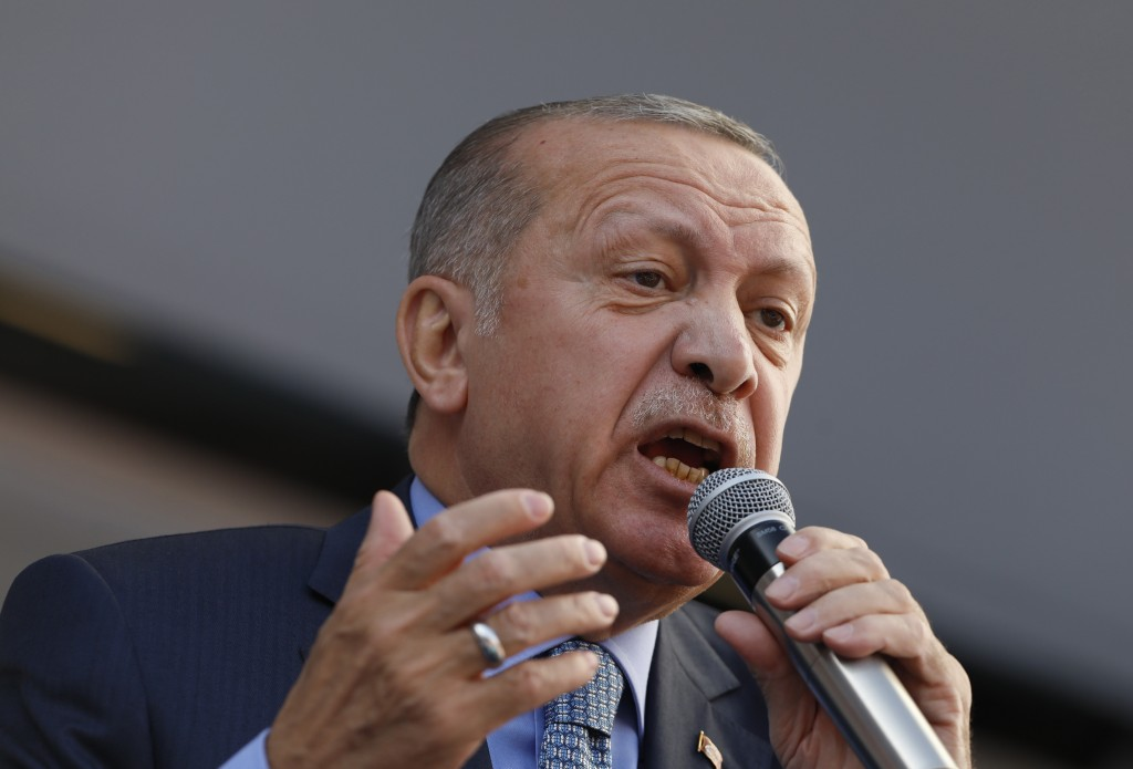 Turkey's President Recep Tayyip Erdogan addresses the supporters of his ruling Justice and Development Party, AKP, during a rally in Ankara, Turkey, T