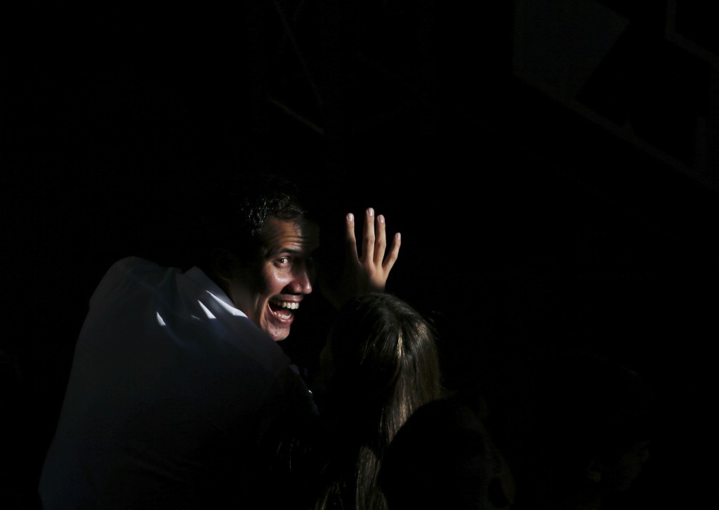 National Assembly President Juan Guaido greets supporters as he arrives to meet with residents in the Hatillo municipality of Caracas, Venezuela, Thur