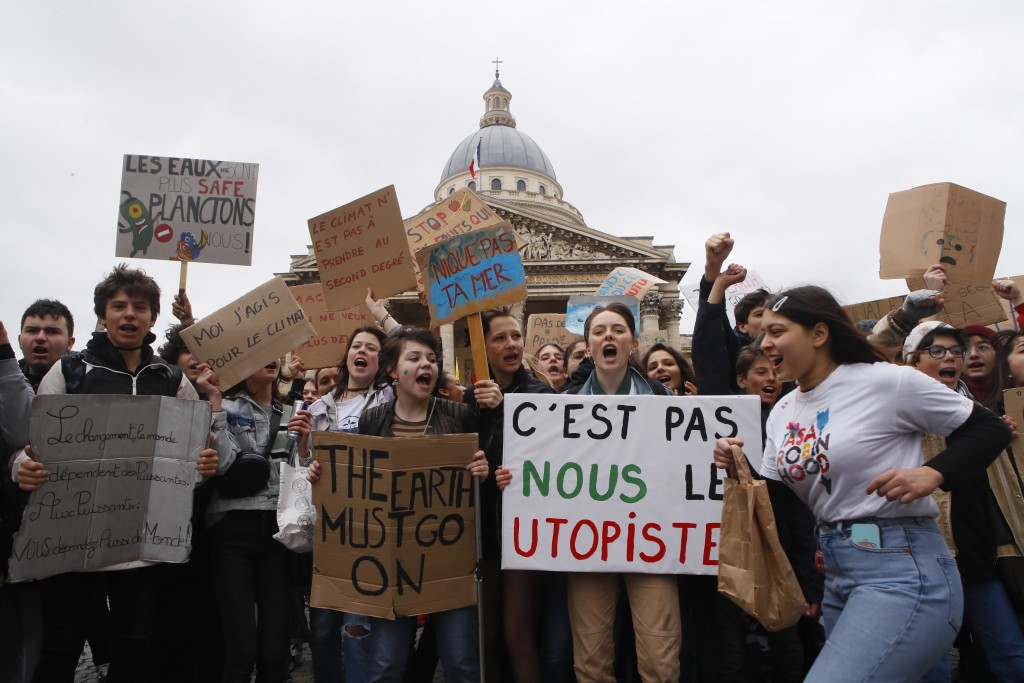 High school students demonstrate outside the Pantheon monument in Paris, Friday, March 15, 2019. Students worldwide are skipping class Friday to take