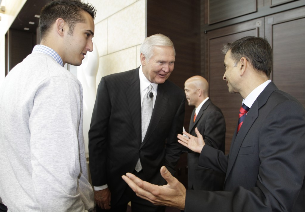 FILE - In this May 23, 2011, file photo, Jerry West, center, a member of the Golden State Warriors basketball club's Executive Board, visits with Warr
