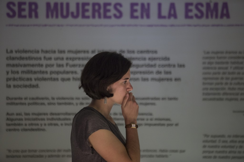 A woman attends the inauguration of an exhibit that recounts harrowing stories of dictatorship-era gender-based violence, at the former Naval Mechanic