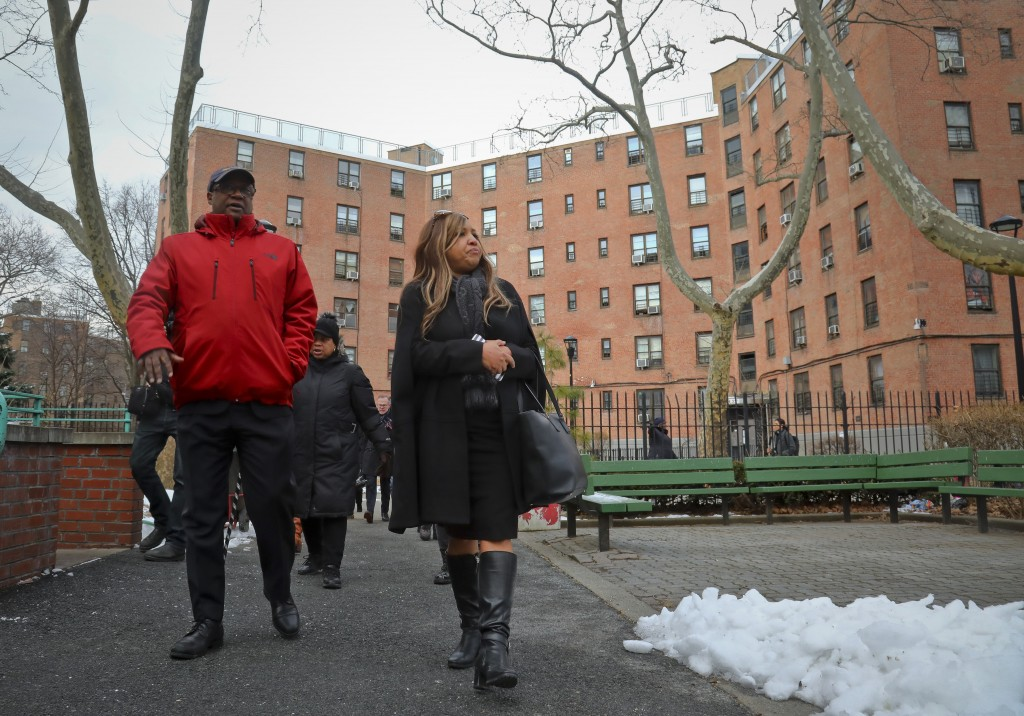 In this March 6, 2019 photo, Lynne Patton, right, HUD executive, and Robert Madison, left, associate director of community organization Jacob Riis Set