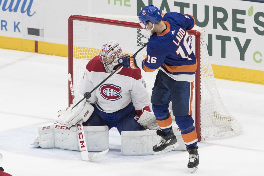 Montreal Canadiens goaltender Carey Price (31) makes a save against New York Islanders left wing Andrew Ladd (16) during the third period of an NHL ho