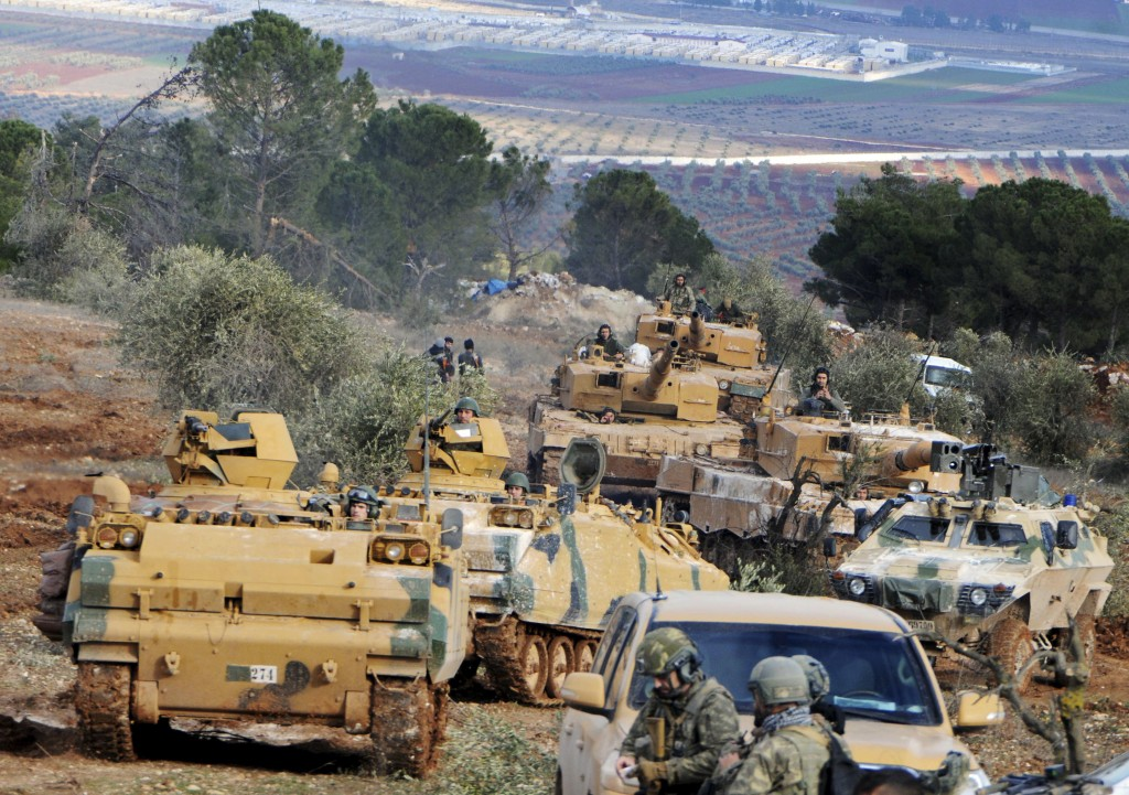 FILE -- In this Jan. 28, 2018 file photo, Turkish troops take control of Bursayah hill, which separates the Kurdish-held enclave of Afrin from the Tur