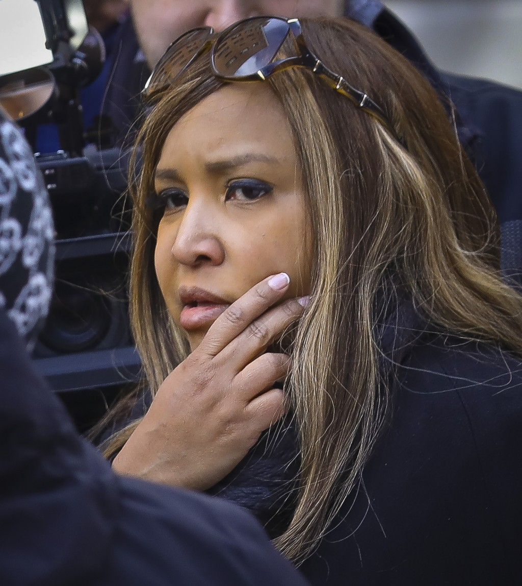 In this March 6, 2019 photo, HUD executive Lynne Patton, listens as a resident at the New York City Housing Authority's Queensbridge Houses in New Yor